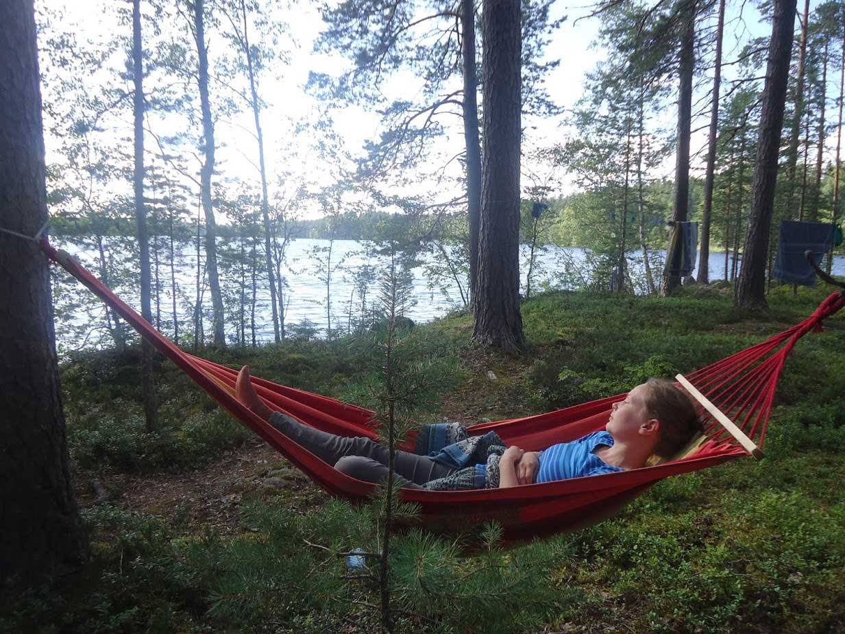 Relaxing in hammock summer retreat Finland