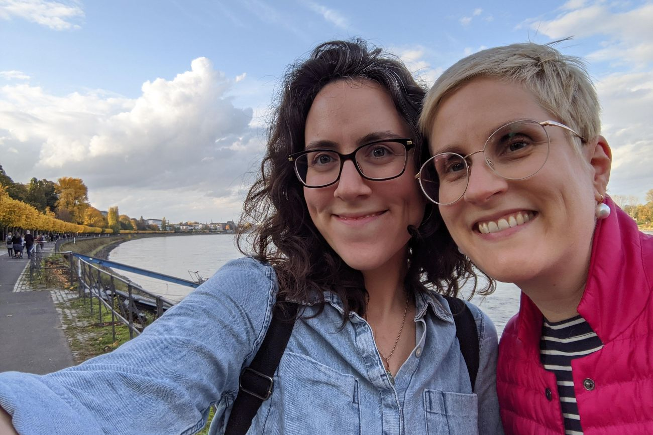 Two Women Standing Beside River In Fall Expressing Appreciation In Radical Honesty