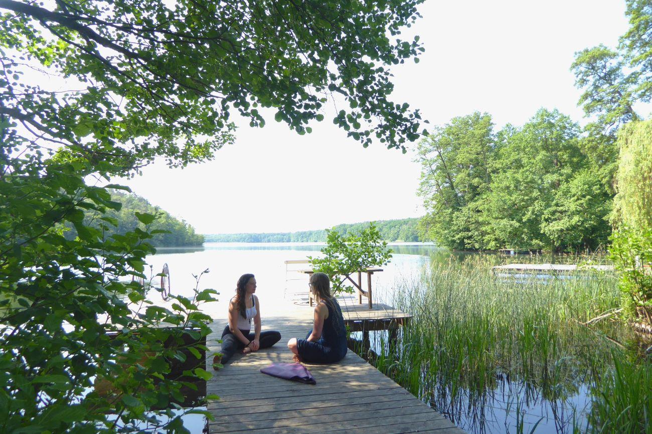 Women Sitting By A Lake